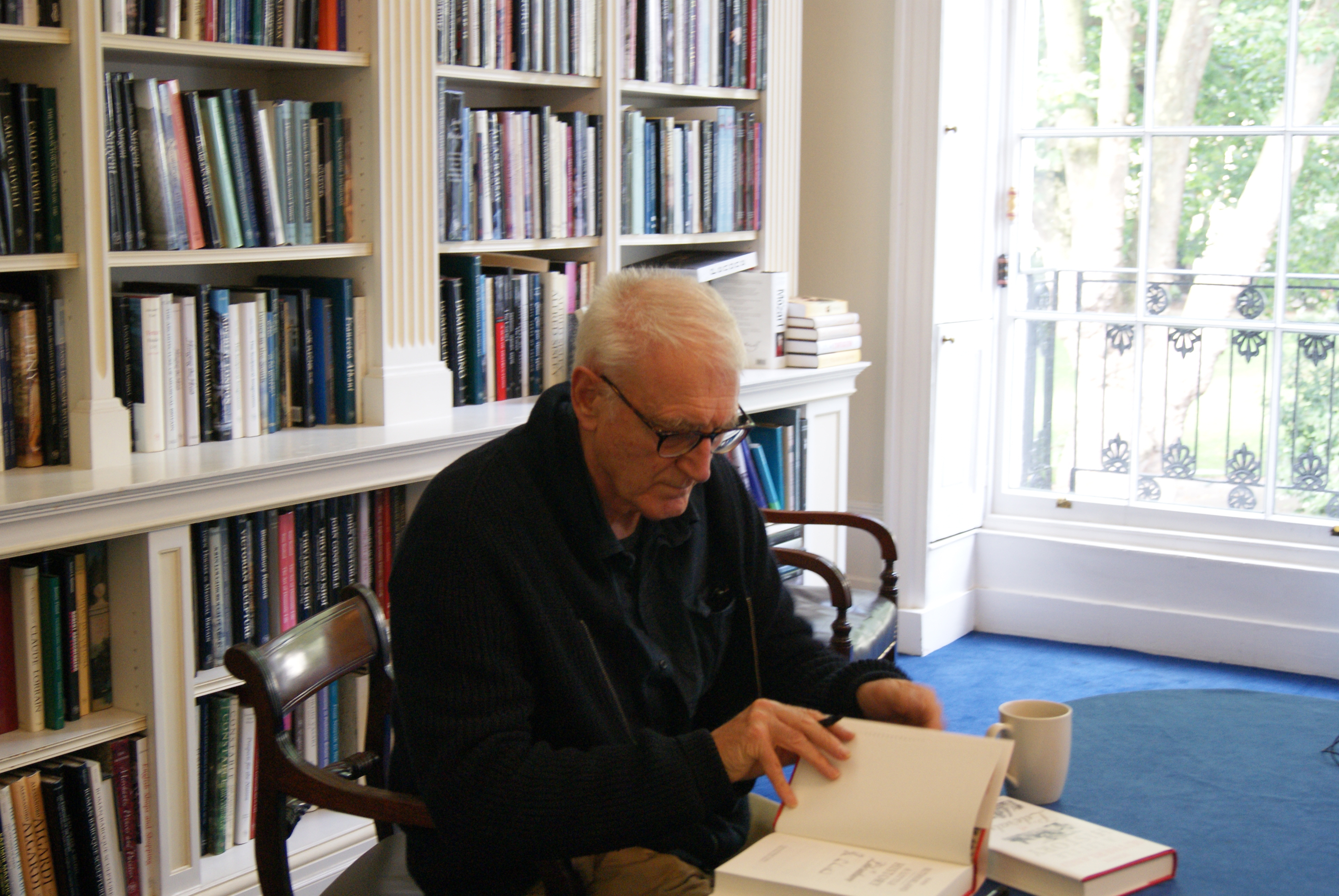 Author John Sutherland signing copies of 'A Little History of Literature'